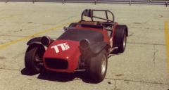 Lotus 7 in pits.JPG